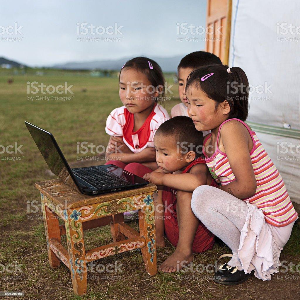 Mongolian children using laptop stock photo