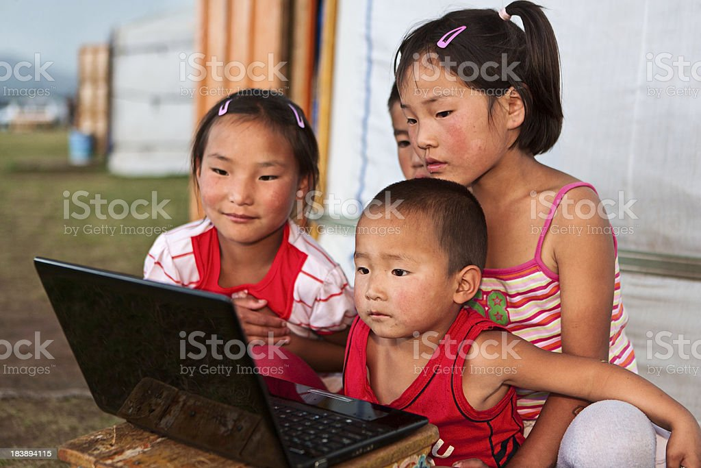 Mongolian children using laptop royalty-free stock photo