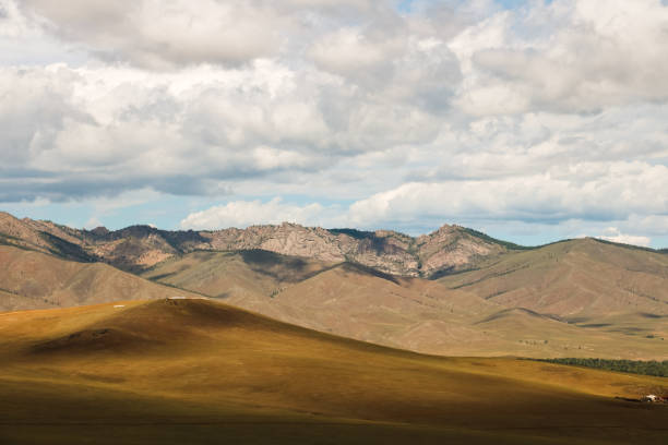 Mongolian countryside with dramatic mountain range and cloudy sky as seen from top of Genghis Khan Statue Complex near Ulaanbaatar (Mongolia, Asia) stock photo