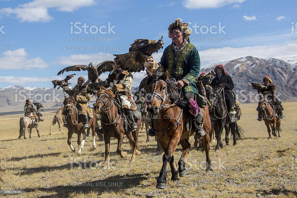 Mongolian eagle hunters riding to the festival. stock photo