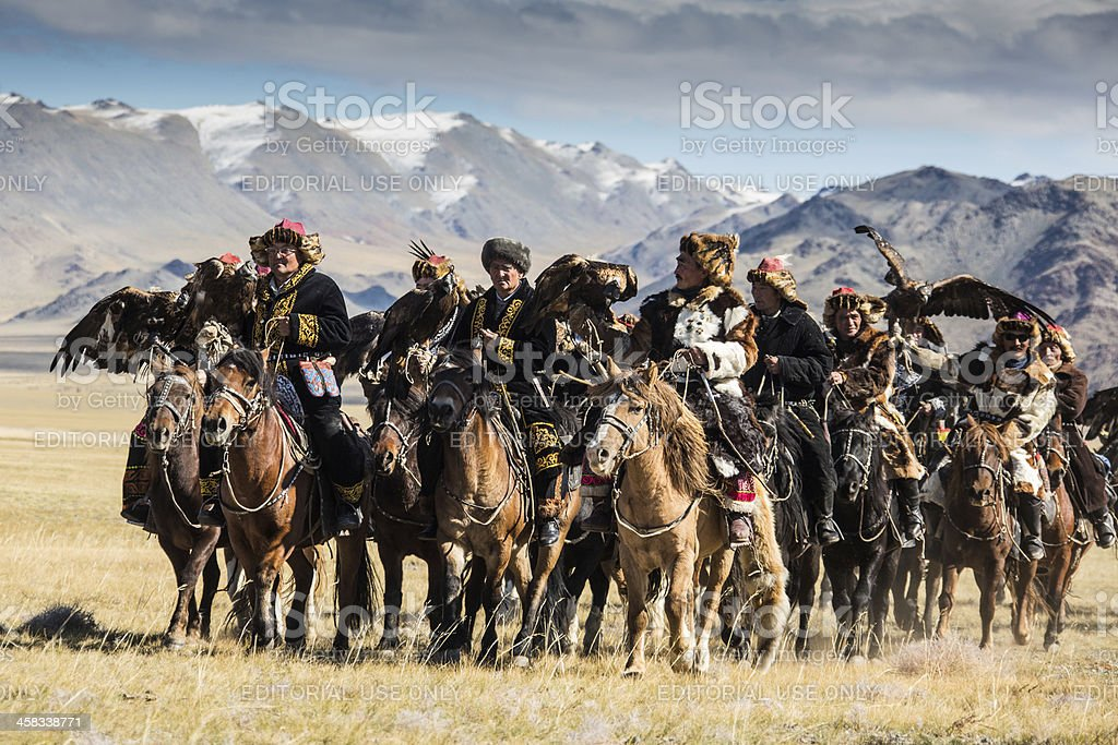 Mongolian eagle hunters riding to the festival. royalty-free stock photo