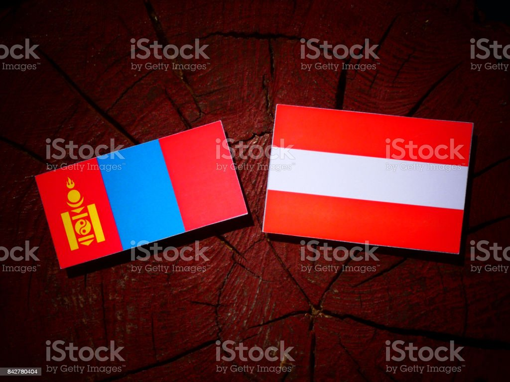 Mongolian flag with Austrian flag on a tree stump isolated stock photo