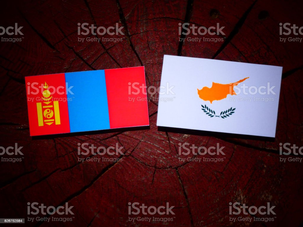 Mongolian flag with Cypriot flag on a tree stump isolated stock photo