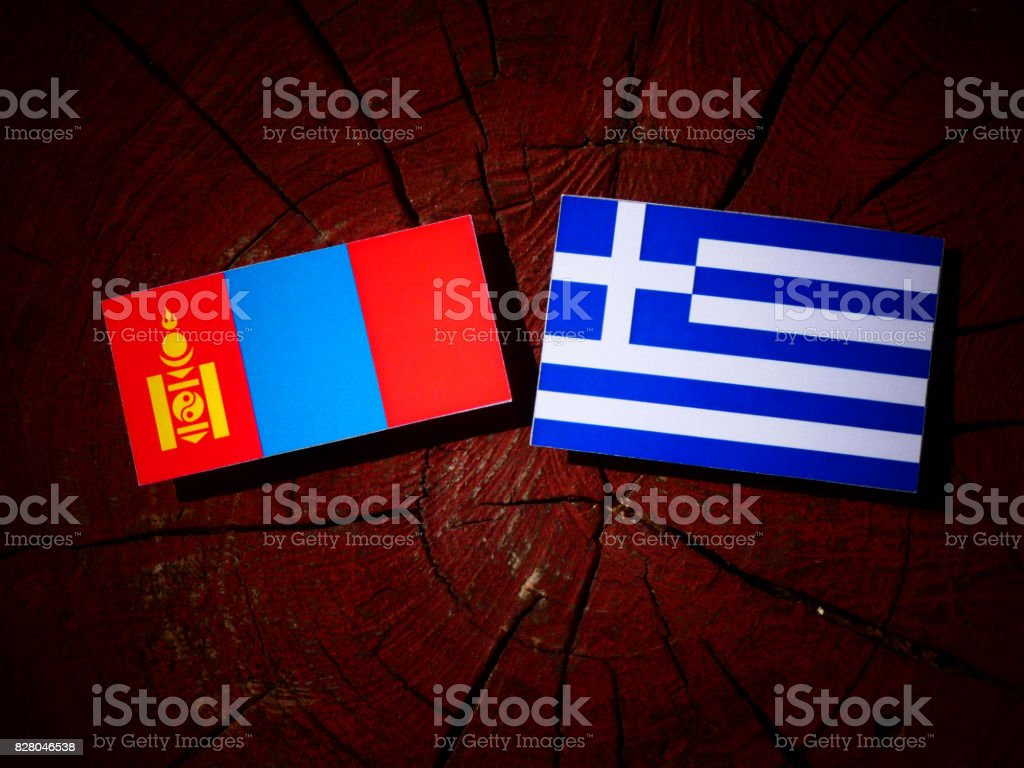 Mongolian flag with Greek flag on a tree stump isolated stock photo