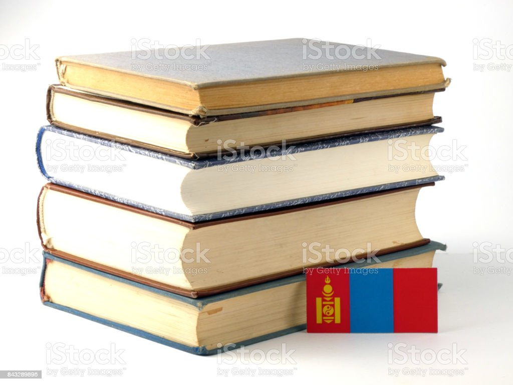 Mongolian flag with pile of books isolated on white background stock photo