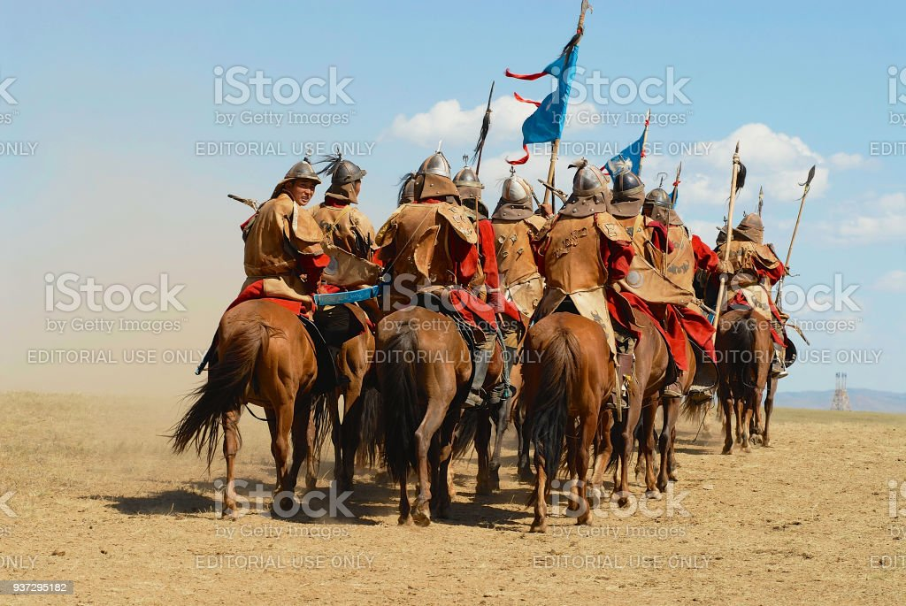 Mongolian horse riders take part in the traditional historical show of Genghis Khan era in Ulaanbaatar, Mongolia. stock photo