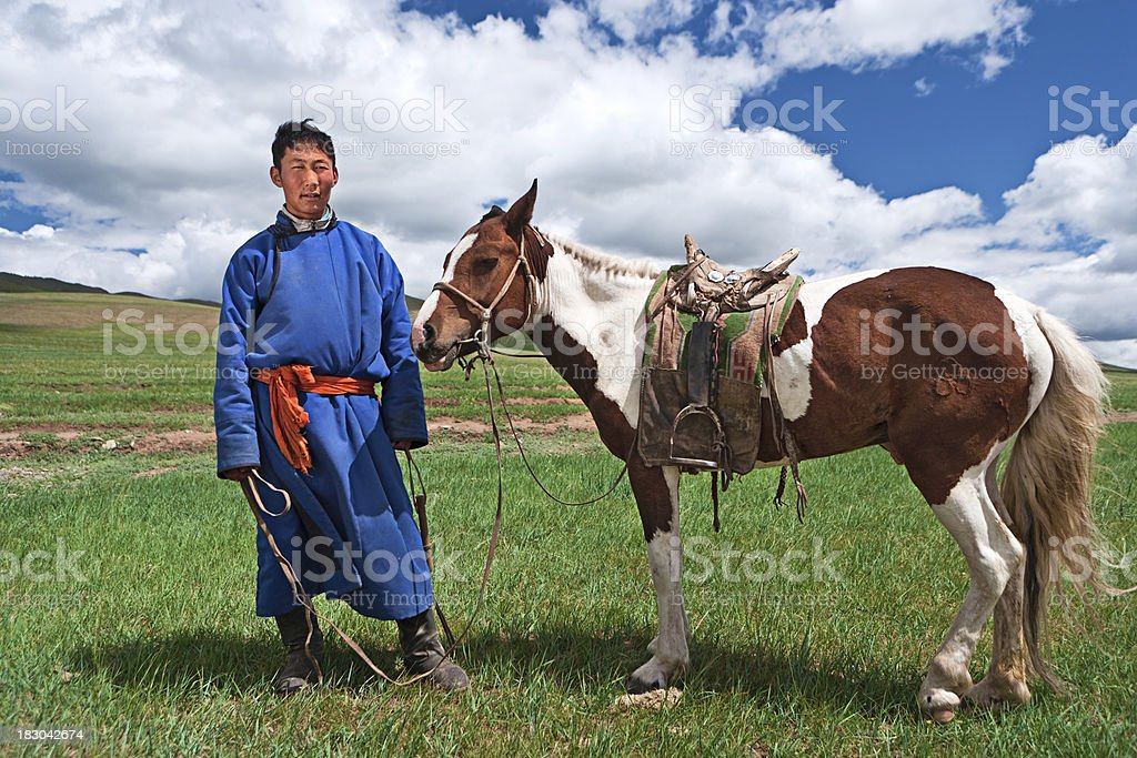 Mongolian horseback rider stock photo
