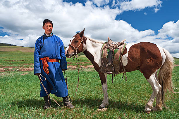 Mongolian horseback rider Mongolian horseback rider, hills in the background.http://bem.2be.pl/IS/mongolia_380.jpg mongolian culture stock pictures, royalty-free photos & images