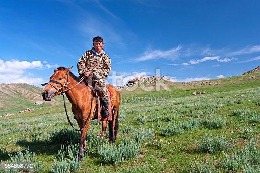 Mongolian horseback rider, meadow in background.