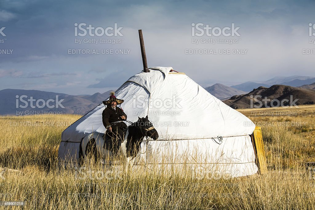 Mongolian jurt with horseman in the Altai area royalty-free stock photo