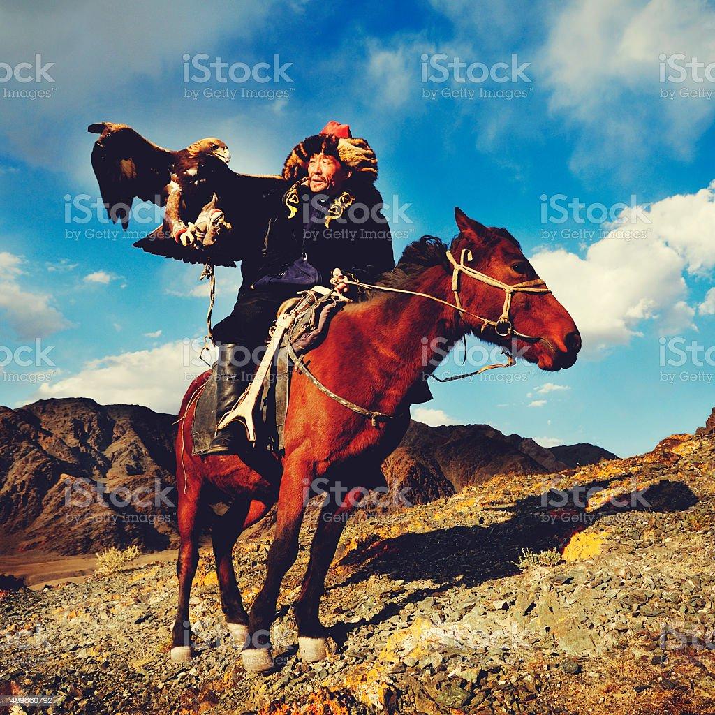 Mongolian Man Trained Eagle Kazakh Olgei Western Concept stock photo