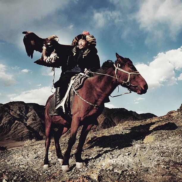 Mongolian Man Trained Eagle Kazakh Olgei Western Concept Mongolian Man Trained Eagle Kazakh Olgei Western Concept mongolian culture stock pictures, royalty-free photos & images