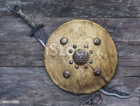 istock Mongolian sword and leather shield of nomads 905472850