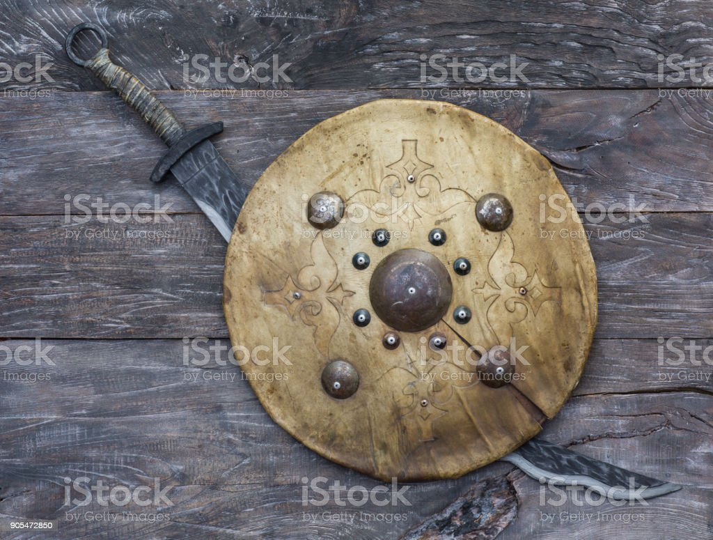 Mongolian sword and leather shield of nomads stock photo