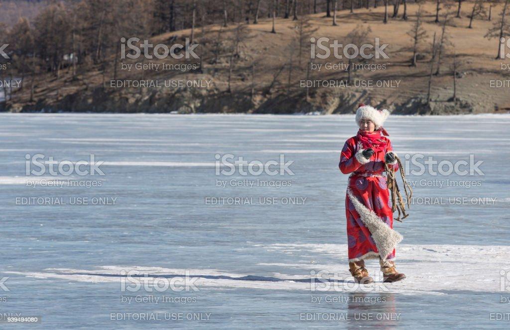 mongolian woman on a frozen lake stock photo
