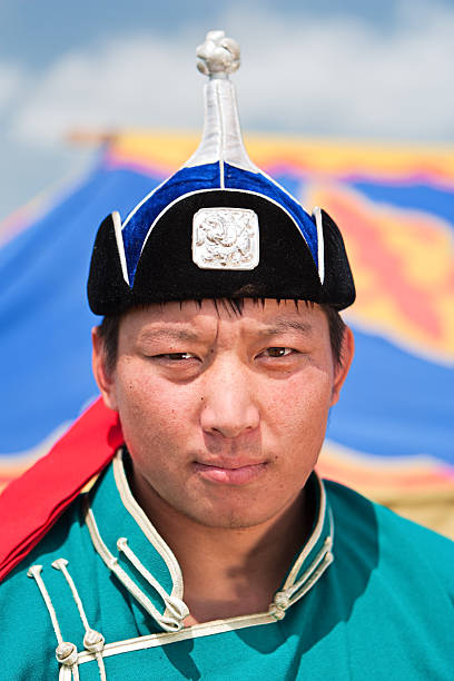 Mongolian wrestler Mongolian wrestlers before the competition at Naadam festival in Ulan Bator. Naadam is the most widely watched festival among Mongols, and is believed to have existed for centuries in one fashion or another. Naadam has its origin in the activities, such as military parades and sporting competitions such as archery, horse riding and wrestling, that followed the celebration of various occasions.http://bem.2be.pl/IS/mongolia_380.jpg mongolian culture stock pictures, royalty-free photos & images