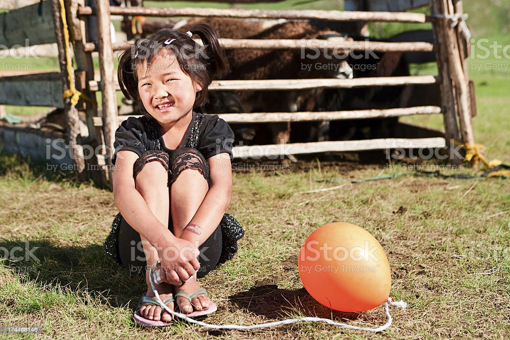 Mongolian young girl with baloon royalty-free stock photo