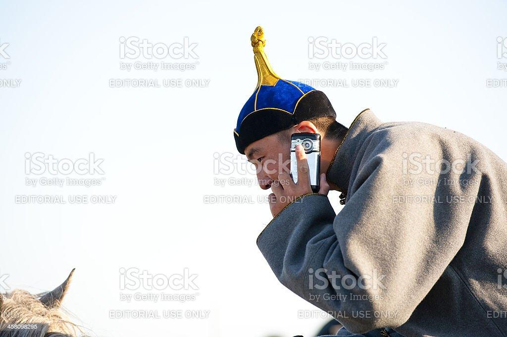 mongolian-young-man-talking-to-phone-pic
