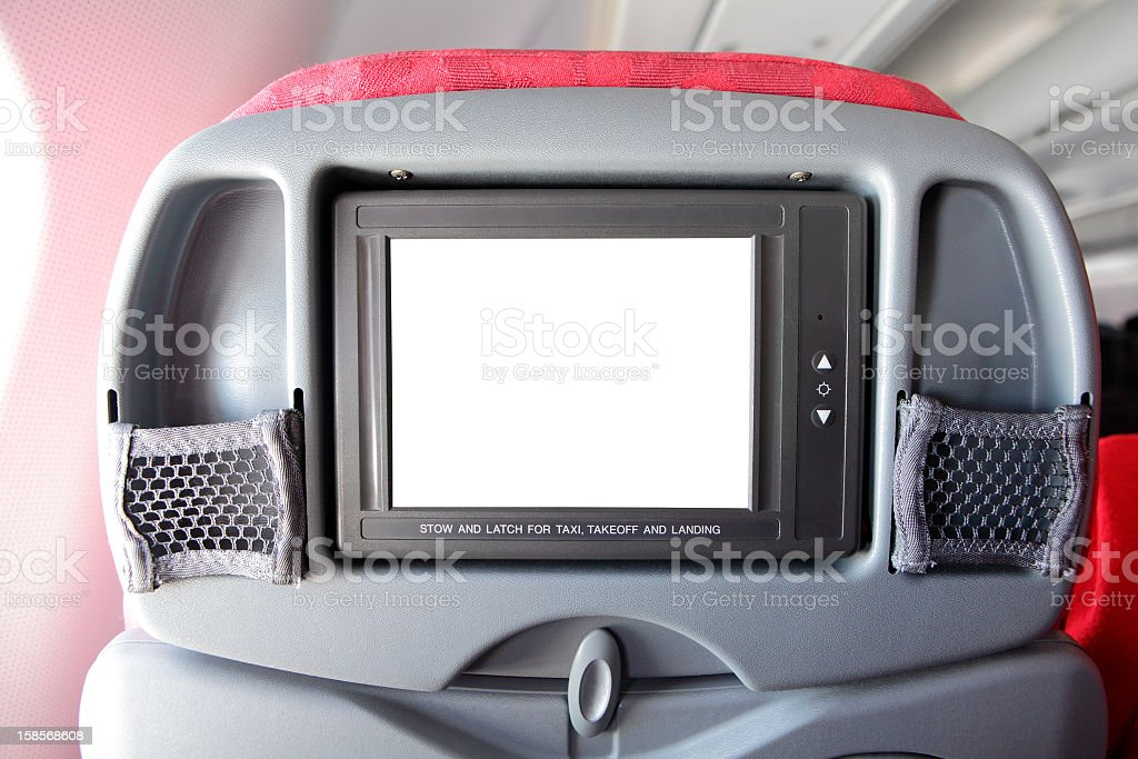 LCD monitor on Passenger Seat of airplane royalty-free stock photo