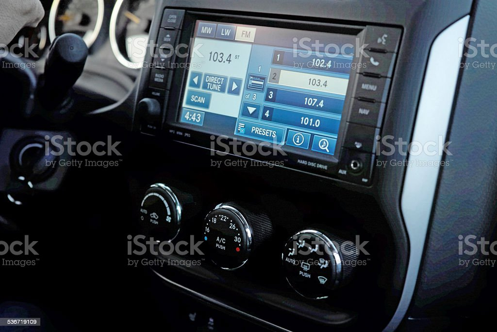 Monitor on the dashboard of the car stock photo