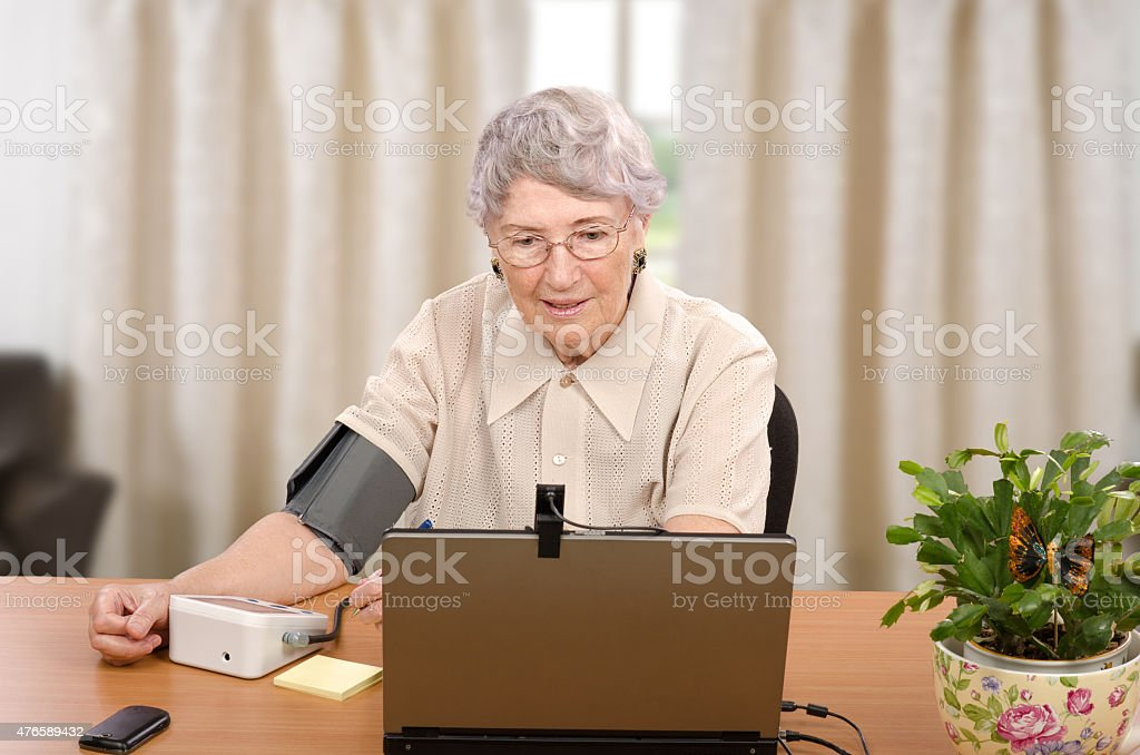 Monitoring blood pressure for telehealth center stock photo