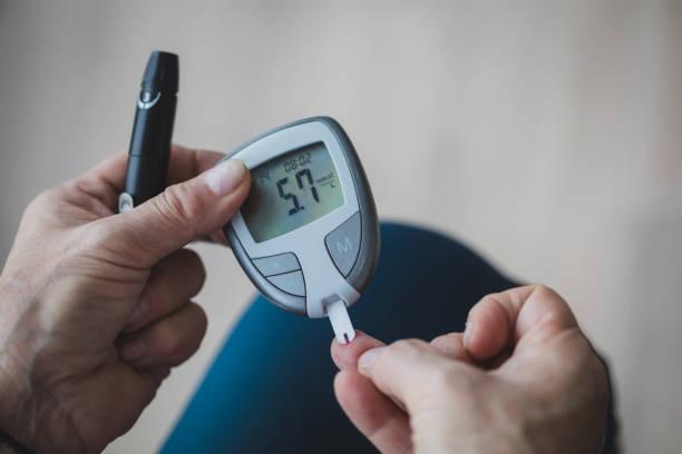 Monitoring Blood Sugar stock photo