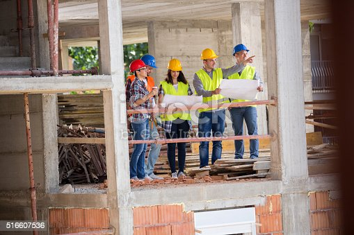 516607254istockphoto Monitoring group at building construction show place of building 516607536