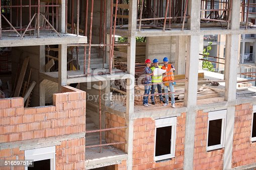 516607254istockphoto Monitoring team on open air building construction 516597514