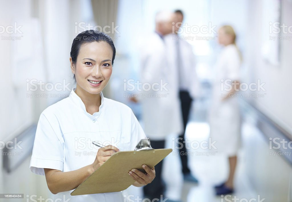 Monitoring the progress of her patients royalty-free stock photo