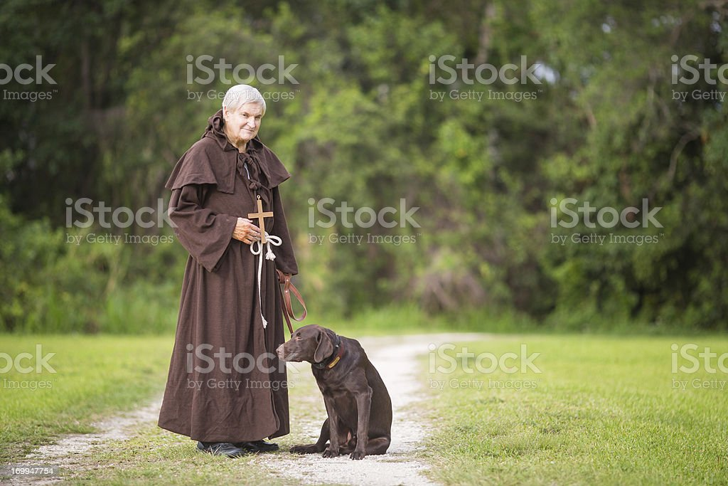 monk and his dog royalty-free stock photo