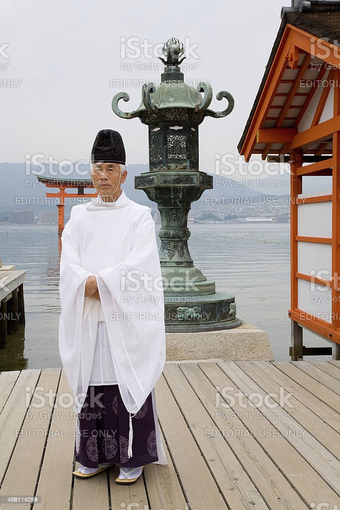 Monk at Miyajima Shrine in Japan stock photo