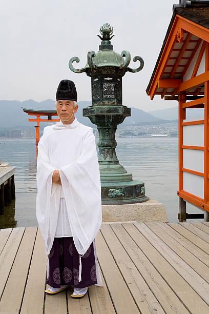 Monk at Miyajima Shrine in Japan stock photo