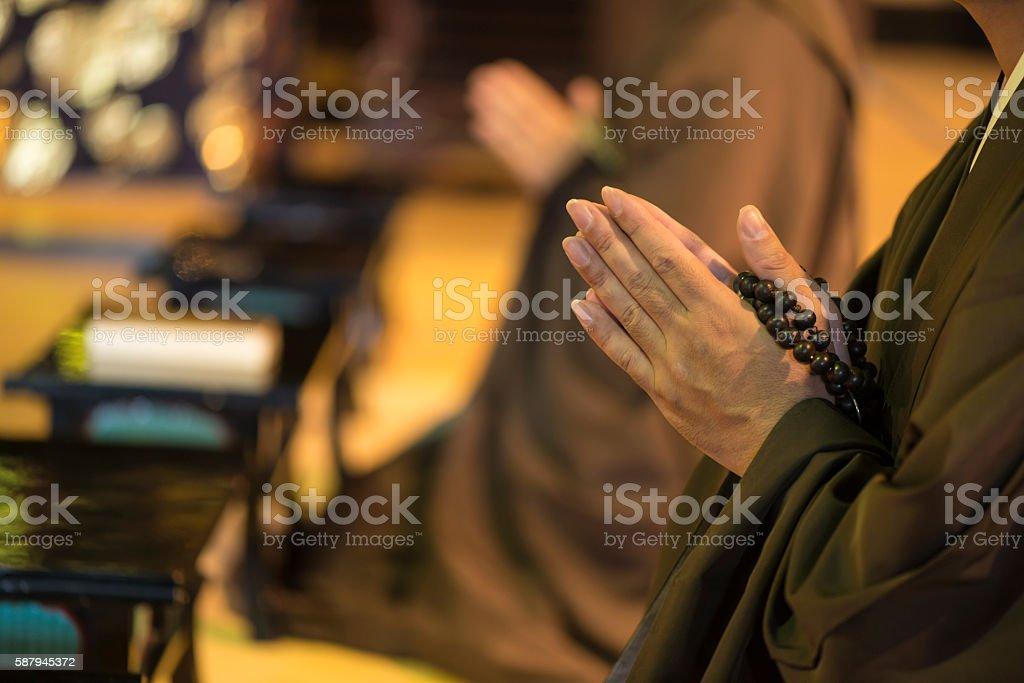 Monk during prayer in Japan stock photo
