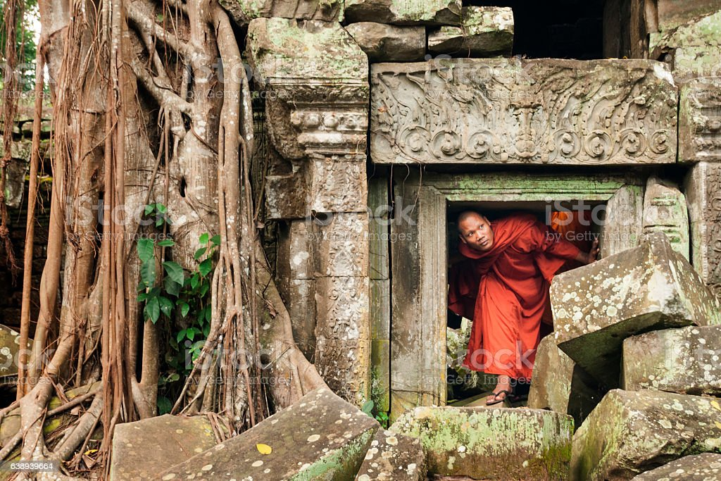 Monk exploring old ruins - Photo