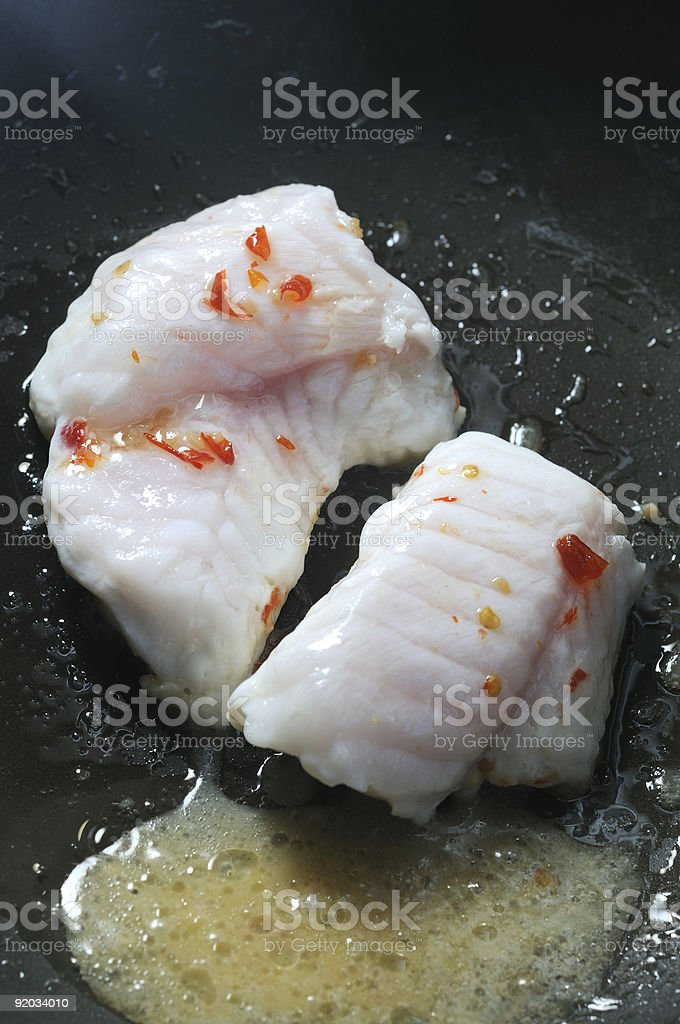 monk fish frying in wok royalty-free stock photo