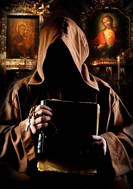Monk in church stock photo