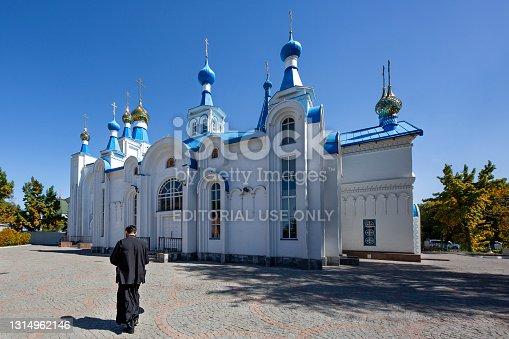 istock Monk in the Russian Orthodox Cathedral in Bishkek, Kyrgyzstan 1314962146