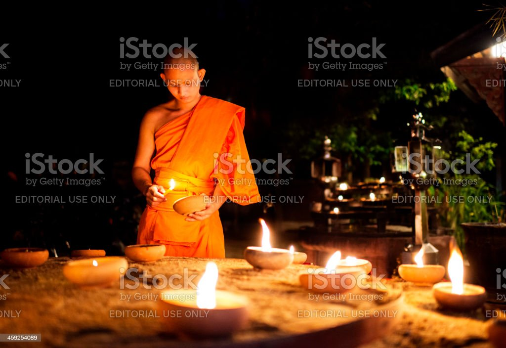 Monk Lighting Candles royalty-free stock photo