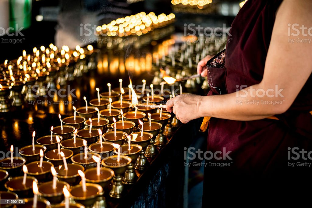 Monk Lighting Prayer lamp on Buddha Purnima stock photo