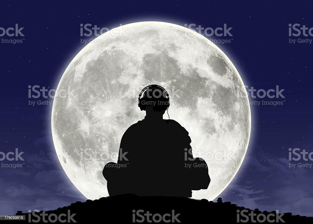 monk listening zen music at the full moon stock photo