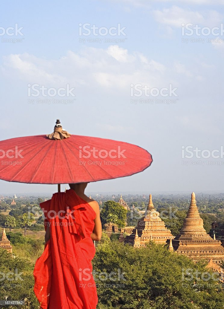 A monk overlooking the Bagan temples of Myanmar royalty-free stock photo