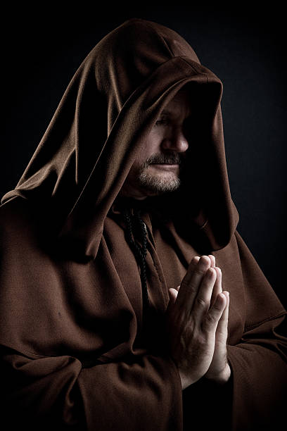 Monk Monk isolated on black background. friar stock pictures, royalty-free photos & images