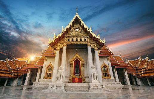 istock Monk prayers to buddha 1050346554
