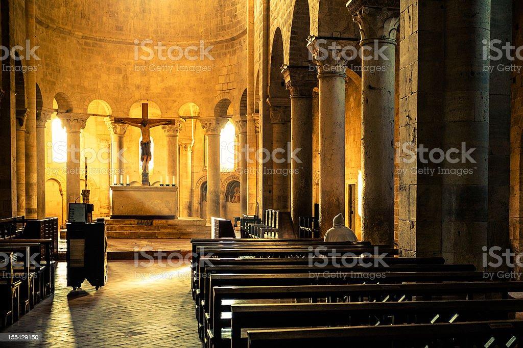 Monk Praying inside Medieval Abbey stock photo