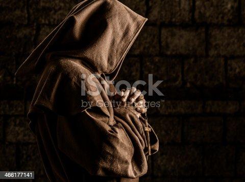 Monk praying in abbey