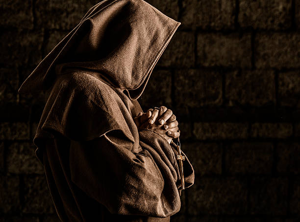 Monk praying Monk praying in abbey monastery stock pictures, royalty-free photos & images