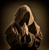 istock Monk praying 467638101
