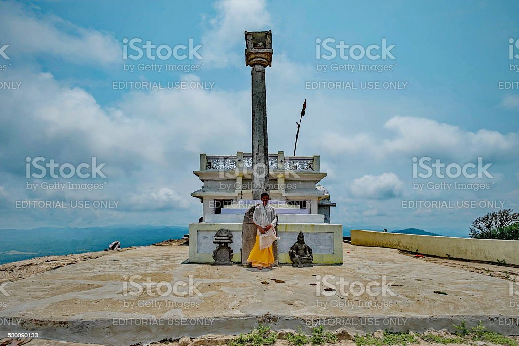 Monk standing on among the oldest temple in India stock photo
