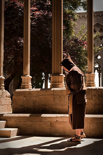 Monk walking in the cloyster stock photo