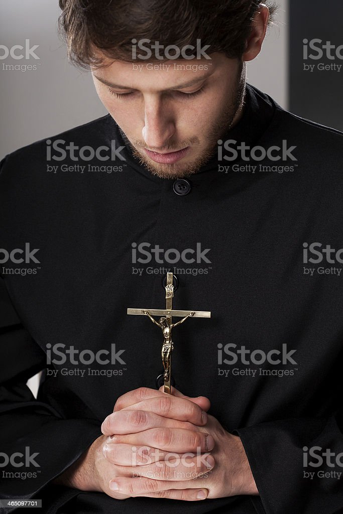 Monk with crucifix stock photo